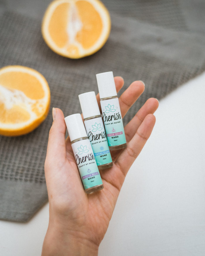 cherish beauty aromatherapy roller collection in lady's hand